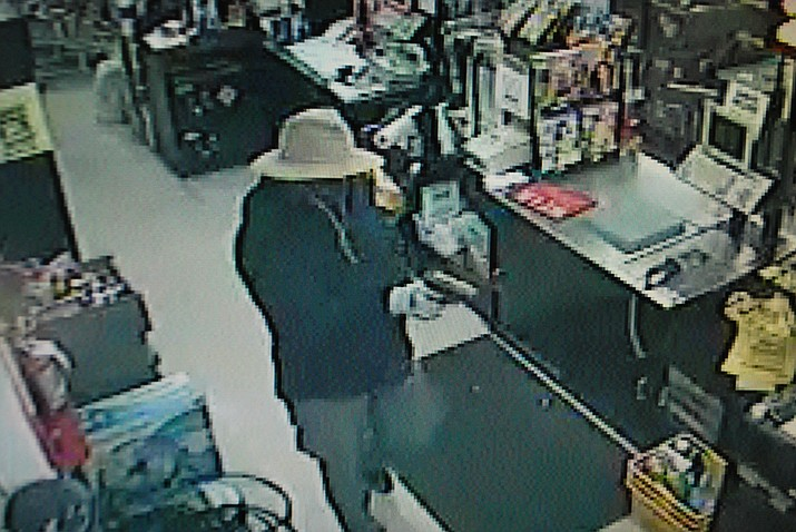 One of the surveillance photos released by Kingman Police showing Thursday's armed robbery of the Dollar General on Stockton Hill Road.