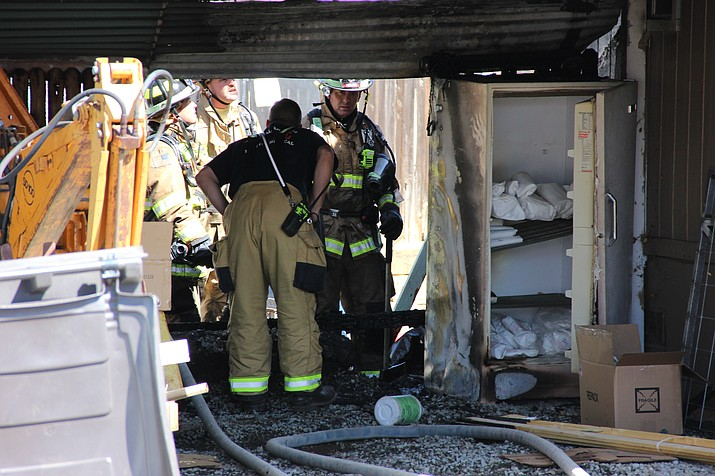 Personnel with the Central Arizona Fire and Medical Authority evaluate the origin of a home fire in the 5000 block of North Pinon Drive in Prescott Valley. The fire started in the area of a freezer, said Central Arizona Fire and Medical Authority Battalion Chief Todd Abel.