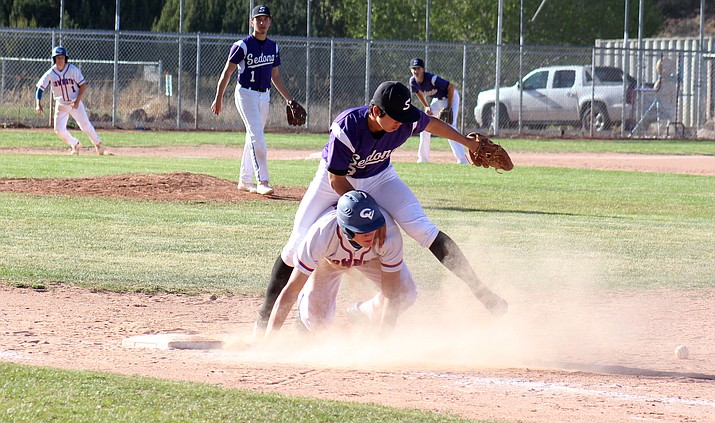 Camp Verde junior Braden Schuh dives back to first base during the Cowboys' 10-1 win at Sedona Red Rock last month. CV hosts the Scorpions on Tuesday at 3:45 p.m. (VVN/James Kelley)