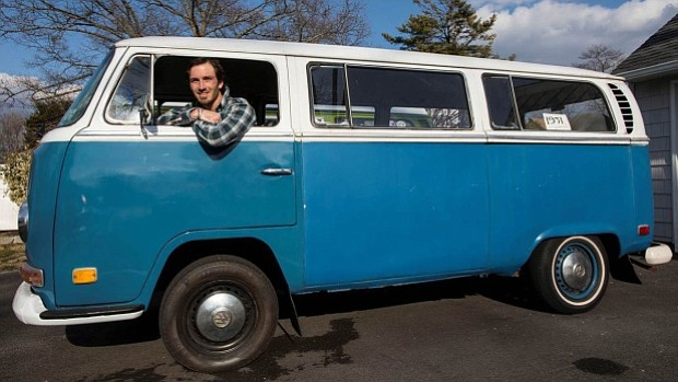 Kyle Cropsey poses with his 1971 Volkswagen bus in Lindenhurst, N.Y., on April 10, 2018. (Chris Ware/Newsday via AP)
