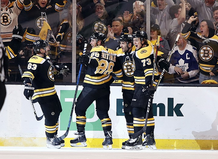 Boston Bruins' Brad Marchand, David Pastrnak, Patrice Bergeron and Charlie McAvoy, from left, celebrate after Pastrnak scored against the Toronto Maple Leafs during the first period of Game 2 of an NHL hockey first-round playoff series in Boston Saturday, April 14, 2018. (Winslow Townson/AP)