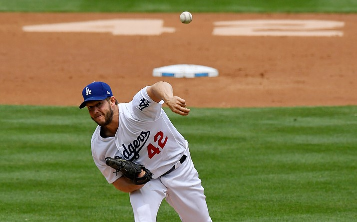 Los Angeles Dodgers starting pitcher Clayton Kershaw throws to the plate during the second inning of a baseball game against the Arizona Diamondbacks, Sunday, April 15, 2018, in Los Angeles. Players wore No. 42 jerseys to commemorate Jackie Robinson Day. (Mark J. Terrill/AP)