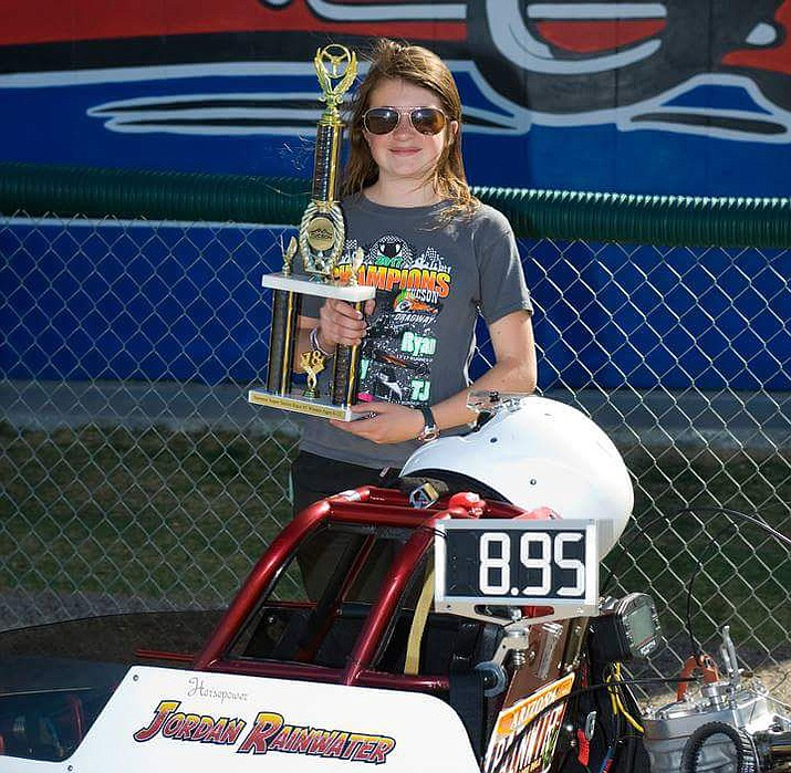 Jordan Rainwater shows off her first-place trophy at a junior dragster event April 8 in Tucson. Rainwater, 12, is part of the NHRA Summit Racing Jr. Drag Racing League. (Julie Rainwater/Courtesy)