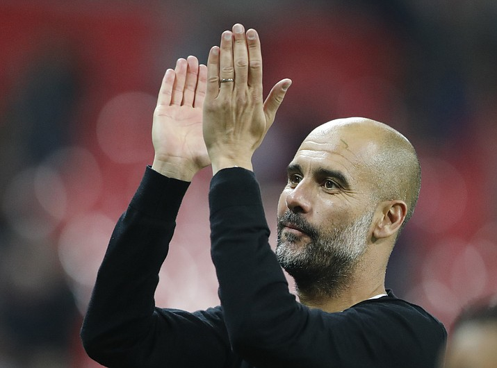 Manchester City manager Pep Guardiola applauds the fans as he walks from the pitch after the end of the English Premier League soccer match between Tottenham Hotspur and Manchester City at Wembley stadium in London, England, Saturday, April 14, 2018. (Frank Augstein/AP)