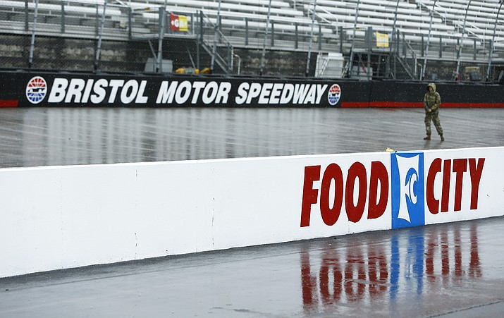 A person walks along the track in the rain before a NASCAR Cup Series auto race, Sunday, April 15, 2018, in Bristol, Tenn. (Wade Payne/AP)