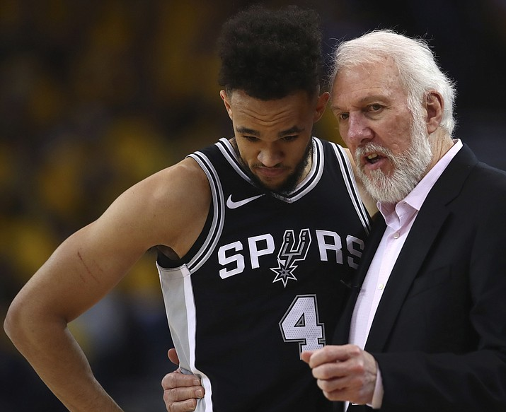 San Antonio Spurs coach Gregg Popovich, right, speaks with Derrick White during the second half in Game 1 of a first-round NBA basketball playoff series against the Golden State Warriors on Saturday, April 14, 2018, in Oakland, Calif. (Ben Margot/AP)