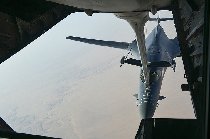 "In this image released by the Department of Defense, a U.S. Air Force B-1 Bomber separates from the boom pod after receiving fuel from an Air Force KC-135 Stratotanker on April 13, 2018, en route to strike chemical weapons targets in Syria. President Donald Trump declared ""Mission Accomplished"" for a U.S.-led allied missile attack on Syria's chemical weapons program, but the Pentagon said the pummeling of three chemical-related facilities left enough others intact to enable the Assad government to use banned weapons against civilians if it chooses. (Department of Defense via AP)"