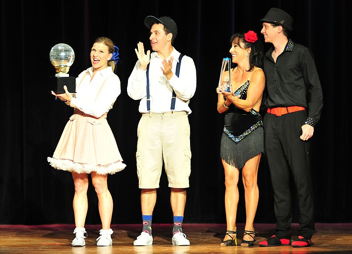 From left, Michelle Fain and Leo Gallegos raised the most money and got the most fan votes while Elena Sanwick and Daniel Garcia, at right, won the judges' votes at the Dancing for the Stars event Saturday, April 14, 2018, in Prescott. (Les Stukenberg/Courier)
