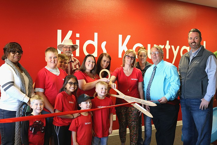 Kids Kourtyard owners and members of the public gathered for the ribbon cutting Friday evening.