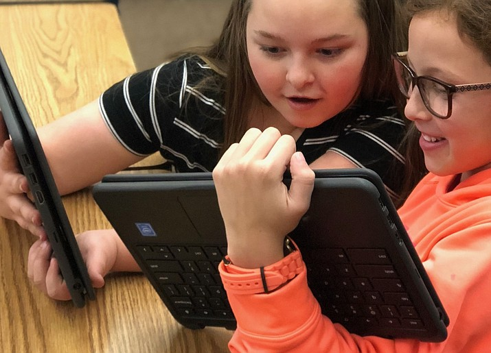 Elle Poitras, at left, and Ava Lee collaborate using Glassford Hill Middle School's new Chromebook 2 in 1 laptop. (HUSD/Courtesy)