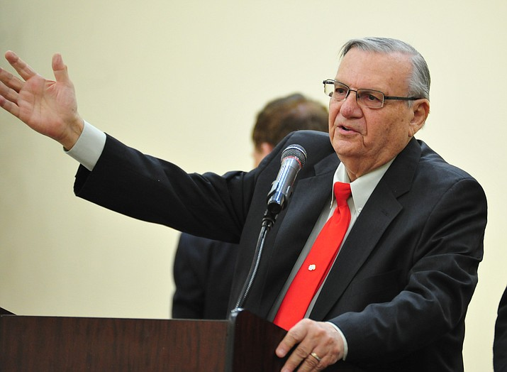 Joe Arpaio tries to reason with protesters as he spoke at a Republican primary United States Senate candidate town hall event  Friday, March 30, 2018 at the Prescott Adult Center. (Les Stukenberg/Courier)