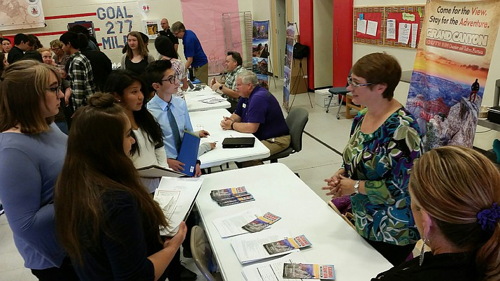 Laura Chastain discusses job opportunities available at the Grand Canyon Chamber of Commerce at the job fair April 11. (Erin Ford/WGCN)