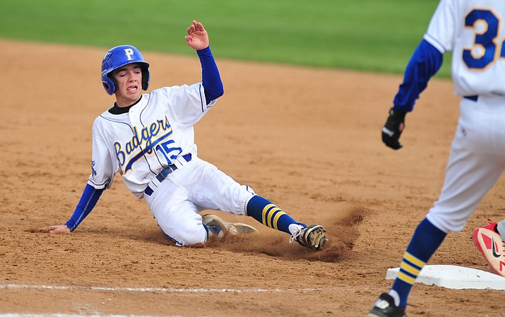 Prescott's Luke Fredrick (15) slides safely back to first base as the Badgers face Mingus on Monday, April 16, 2018 in Prescott. Prescott suffered a 1-0 loss to the Grand Canyon region-leading Marauders. (Les Stukenberg/Courier)