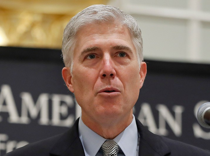 In this Sept. 28, 2017, file photo Supreme Court Justice Neil Gorsuch speaks in Washington. The Supreme Court said April 17, 2018, that part of a federal law that makes it easier to deport immigrants who have been convicted of crimes is too vague to be enforced. The court's 5-4 decision — an unusual alignment in which Gorsuch joined the four liberal justices — concerns a catchall provision of immigration law that defines what makes a crime violent. (AP Photo/Pablo Martinez Monsivais, File)