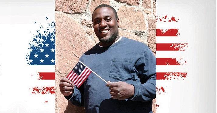 From Jamaica, Lennox Mills has been in the U.S. since 2009 on a work visa and green card. This year he will become a U.S. citizen. (Loretta Yerian/WGCN)