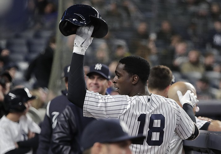 New York Yankees' Didi Gregorius (18) raises his batting helmet to the crowd after hitting a solo home run, his second of the game, against the Miami Marlins during the seventh inning Monday, April 16, 2018, in New York. (Julie Jacobson/AP)