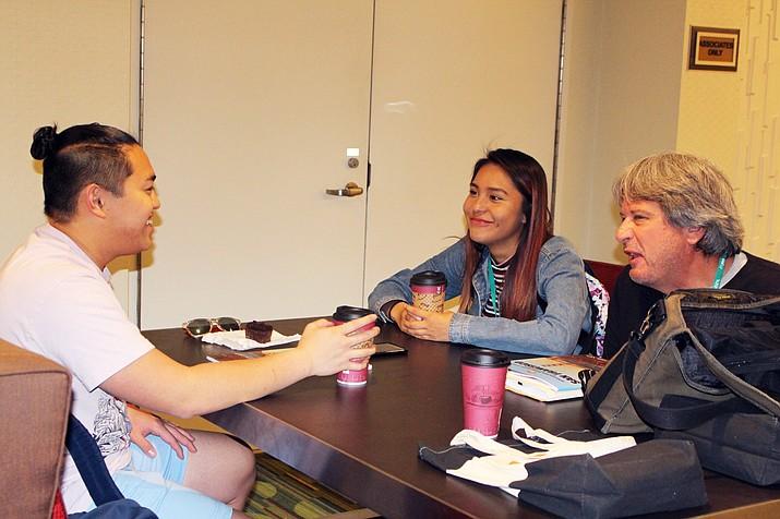 Former Journalism Education Association President Mark Newton chats with Hopi High journalism students Sean Bolus and Ellyse Fredericks. (Stan Bindell/NHO)