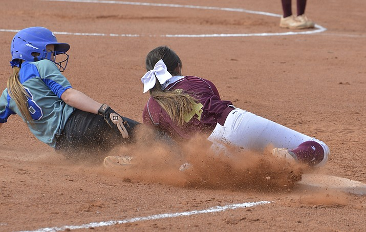 Lady Bulldog Macee Rae Cunningham tags out a Snowflake  player in an April 10 game. The Lady Bulldogs are 14-6 after recent wins. (Todd Roth/NHO)