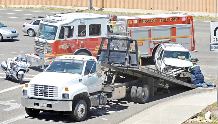 A tow truck driver loads an SUV that was involved in a wreck. Prescott Valley Police Department started looking into the practices of local towing companies after an incident was brought to their attention. Since then the department has changed its policies to help citizens. (File Photo/Courier)