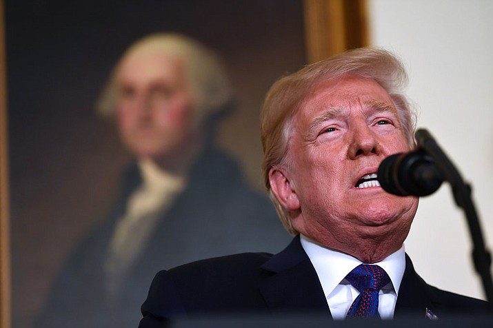 President Donald Trump speaks in the Diplomatic Reception Room of the White House on April 13, 2018, in Washington, about the United States' military response to Syria's chemical weapon attack on April 7. (AP Photo/Susan Walsh)