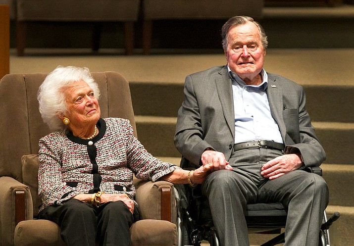 In this March 8, 2017, file photo, the Mensch International Foundation presented its annual Mensch Award to former U.S. President George H.W. Bush and former first lady Barbara Bush at an awards ceremony hosted by Congregation Beth Israel in Houston. A family spokesman said Tuesday, April 17, 2018, that former first lady Barbara Bush has died at the age of 92. ( Steve Gonzales/Houston Chronicle via AP, File)
