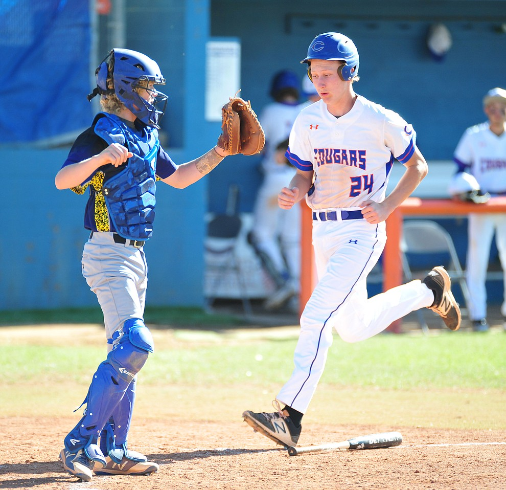 Chino Valley's Thomas Bartels scores as the Cougars host the Kingman Bulldogs in baseball Tuesday, April 17, 2018 in Chino Valley. (Les Stukenberg/Courier)