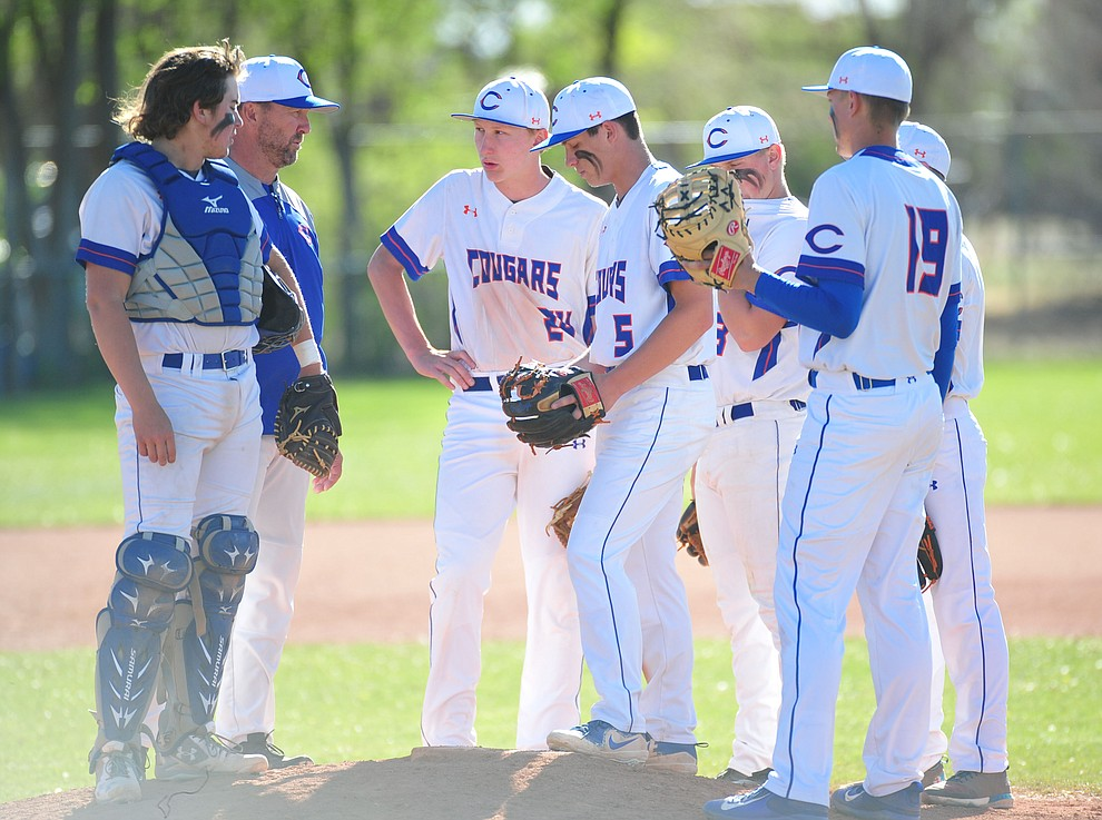 Chino ValleyHead Coach Mark Middleton talks to his players as the Cougars host the Kingman Bulldogs in baseball Tuesday, April 17, 2018 in Chino Valley. (Les Stukenberg/Courier)