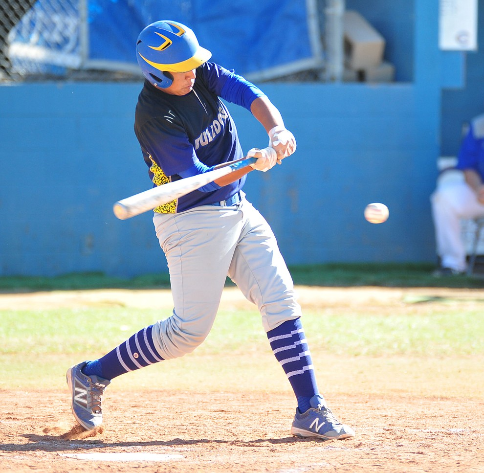 Kingman's Kyler Martin singles as the Bulldogs traveled to play the Chino Valley Cougars in baseball Tuesday, April 17, 2018 in Chino Valley. (Les Stukenberg/Courier)