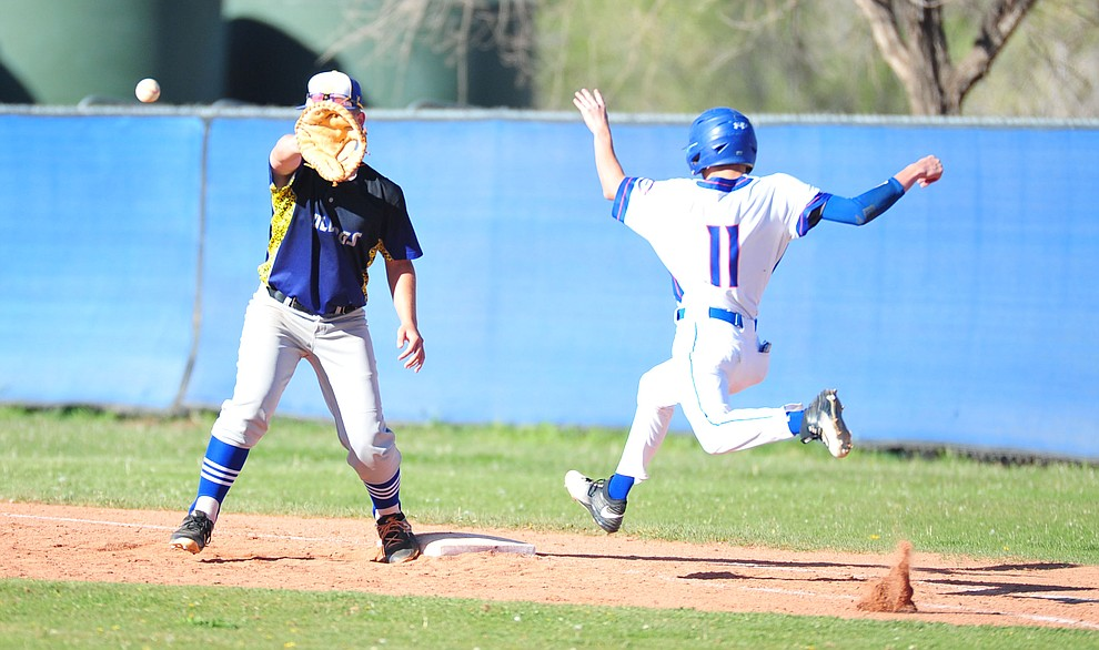 Kingman's Rilee Araya gets the out on Kaleb Chacon at first as the Bulldogs traveled to play the Chino Valley Cougars in baseball Tuesday, April 17, 2018 in Chino Valley. (Les Stukenberg/Courier)