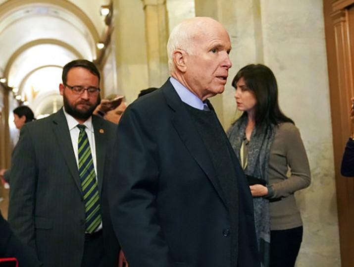 In this Nov. 13, 2017 file photo Sen. John McCain, R-Ariz., arrives on Capitol Hill in Washington. The Arizona Legislature is moving to ensure that ailing Sen. John McCain's seat isn't on the November ballot if he leaves office. (AP Photo/Pablo Martinez Monsivais, File)