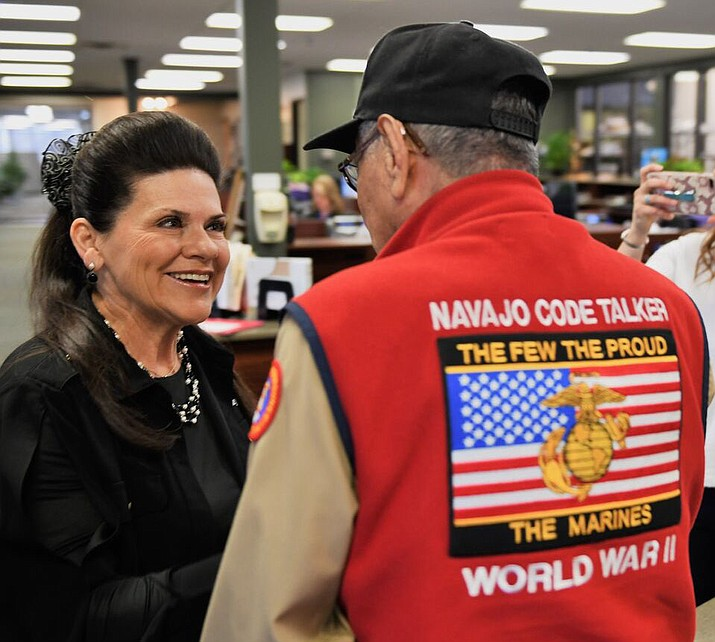 At right, Peter MacDonald, a veteran of WWII, is pictured March 23, 2018, in Eden Prairie, Minnesota, with Tani Austin, of the nonprofit Starkey Hearing Foundation, which fitted MacDonald with hearing aids.