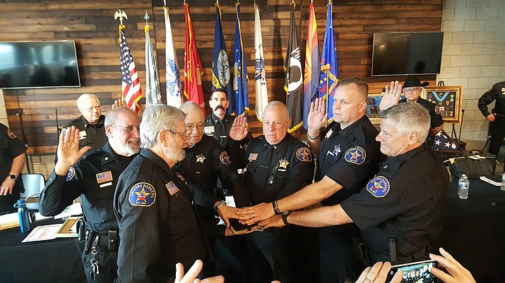 Col. Cressman's swearing in ceremony. Cressman is fourth from left. (Courtesy)