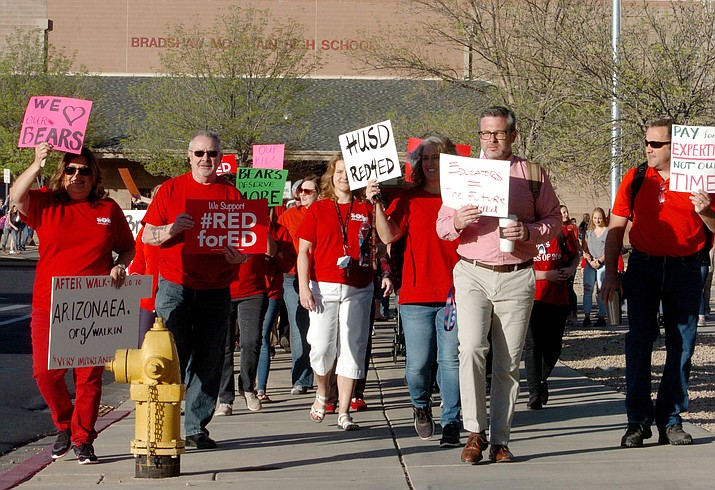 More than 100 teachers, parents, support staff, students and supporters march at Bradshaw Mountain High School to support pay raises for teachers in Arizona on Wednesday, April 11, 2018. (Les Stukenberg/Courier)