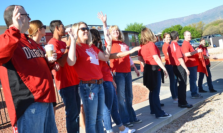 "Teachers, staff and community members have a ""walk in"" Wednesday morning before school hours at Mingus Union High School to bring attention to the state of education in Arizona. VVN/Vyto Starinskas"