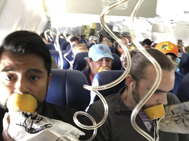 "In this April 17, 2018 photo provided by Marty Martinez, Martinez, left, appears with other passengers after a jet engine blew out on the Southwest Airlines Boeing 737 plane he was flying in from New York to Dallas, resulting in the death of a woman who was nearly sucked from a window during the flight with 149 people aboard. A preliminary examination of the blown jet engine that set off a terrifying chain of events showed evidence of ""metal fatigue,"" according to the National Transportation Safety Board. (Marty Martinez)"