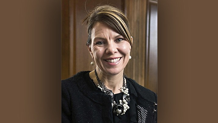 In this 2017 photo, Jennifer Riordan, of Albuquerque, N.M., poses for a photo in Albuquerque. Family, friends and community leaders are mourning the death of Riordan, a bank executive on a Southwest Airlines jet that blew an engine as she was flying home from a business trip to New York. (Marla Brose/The Albuquerque Journal via AP)
