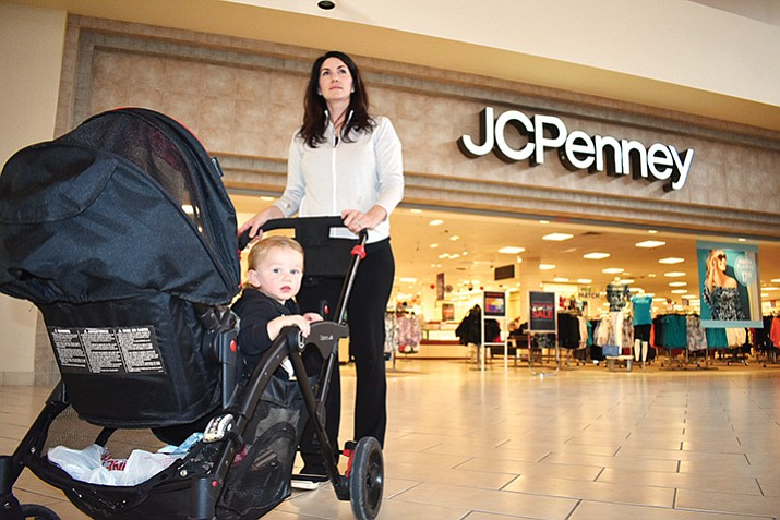 In this Courier file photo, 17-month-old Arnold Masters peeks out of his stroller as his mom, Prescott Valley resident Alexandria Masters, leaves the JCPenney store in the Gateway Mall. The Prescott JCPenney store was honored as a top performing store with its company's Founder's Award at a special ceremony held April 5, in Grapevine, Texas.  (Richard Haddad/WNI file photo)