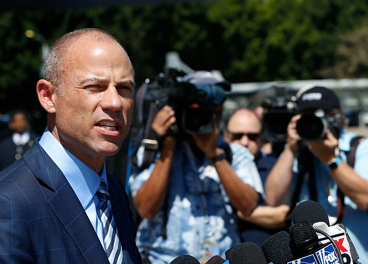 Stormy Daniels' attorney, Michael Avenatti talks to the media outside federal court in Los Angeles Friday, April 20, 2018. A federal judge on Friday told lawyers for President Donald Trump's attorney Michael Cohen that Cohen needs to file a declaration in court in order to delay a lawsuit filed by porn actress Stormy Daniels aimed at dissolving a confidentiality agreement that prevents her from talking about an alleged affair with Trump. (AP Photo/Damian Dovarganes)