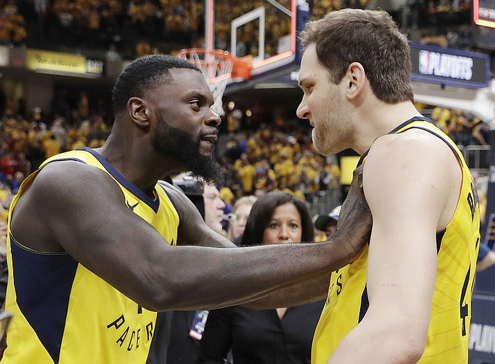 Indiana Pacers' Lance Stephenson, left, celebrates with Bojan Bogdanovic after Indiana defeated the Cleveland Cavaliers 92-90 in Game 3 of a first-round NBA basketball playoff series Friday, April 20, 2018, in Indianapolis. (AP Photo/Darron Cummings)