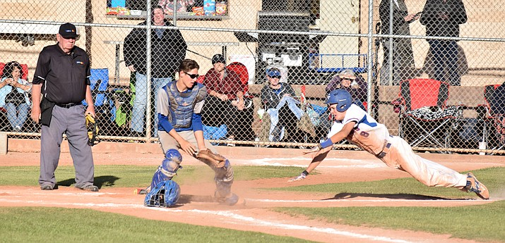 Camp Verde sophomore Coke Bast scores the winning run in the Cowboys' 7-6 win over Surprise Paradise Honors on Friday at home. (VVN/James Kelley)
