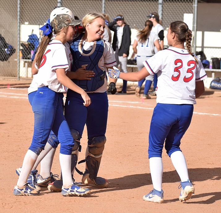 Camp Verde softball players celebrate their walk off win over Surprise Paradise Honors on Friday afternoon at home. The 5-4 victory clinched the 2A Central Region championship for No. 2 Cowboys. (VVN/James Kelley)