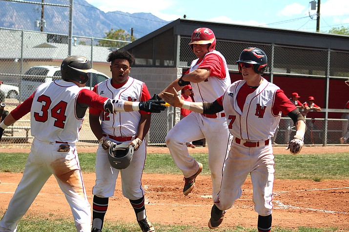 From left, Lee Williams' Paul Giglio, Addis Guzman, Matt Bathauer and Carter Rhoades high five each other Friday during a 13-2 win in game one of a doubleheader against Mingus.