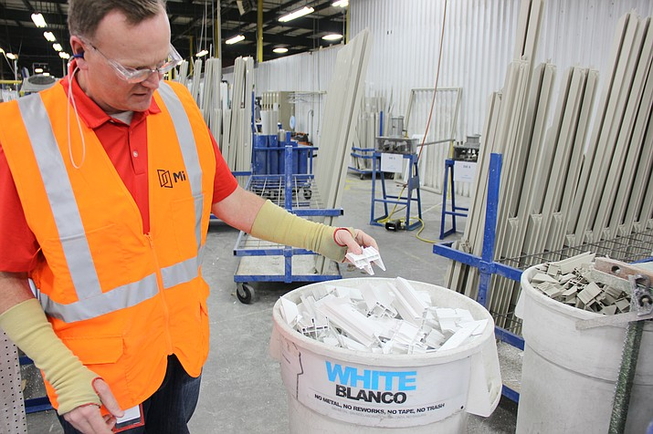Mike Reinert, general manager of MI Windows and Doors in Prescott, talks about some of the recyclable material the company sends to Vinyl Visions in Prescott to be melted down and re-purposed. (Max Efrein/Courier)