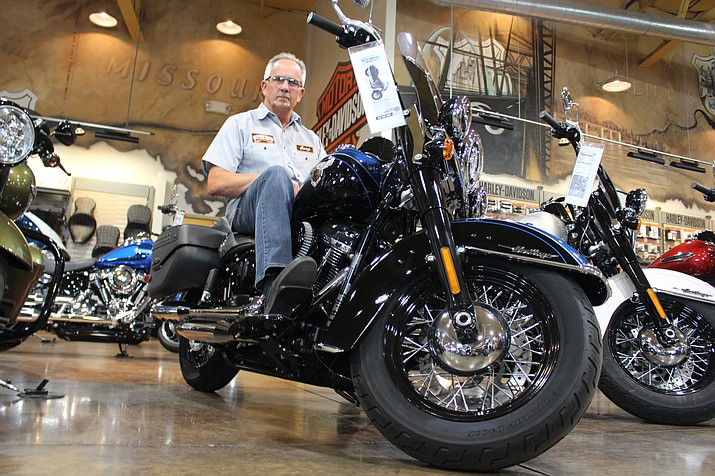 Jerry Cooper, general manager of Mother Road Harley-Davidson in Kingman, sits on a 2018 Softail on the showroom floor. The dealership will host a three-day party April 26-28 in conjunction with Laughlin River Run 2018.