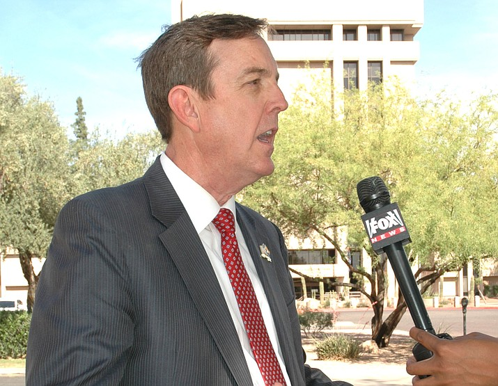 Republican Ken Bennett, in front of the Capitol tower, details Saturday why he wants to replace incumbent Doug Ducey as governor. (Howard Fischer/Capitol Media Services)