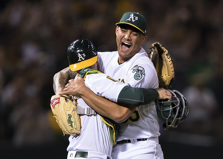 Oakland Athletics starting pitcher Sean Manaea, right, celebrates with catcher Jonathan Lucroy after pitching a no-hitter against the Boston Red Sox during a baseball game in Oakland, Calif., Saturday, April 21, 2018. The A's won 3-0. (John Hefti/AP)