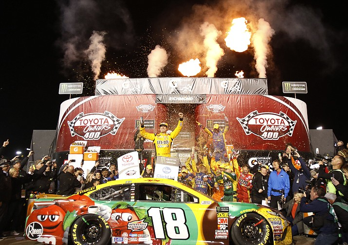 Kyle Busch, center, celebrates in Victory Lane after winning the NASCAR Cup Series auto race at Richmond Raceway in Richmond, Va., Saturday, April 21, 2018. (Steve Helber/AP)