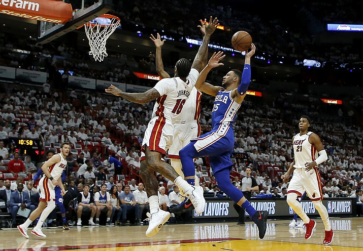 Philadelphia 76ers guard Ben Simmons (25) shoots in the first quarter as Miami Heat forward James Johnson (16) defends in Game 4 of a first-round NBA basketball playoff series, Saturday, April 21, 2018, in Miami. (Joe Skipper/AP)
