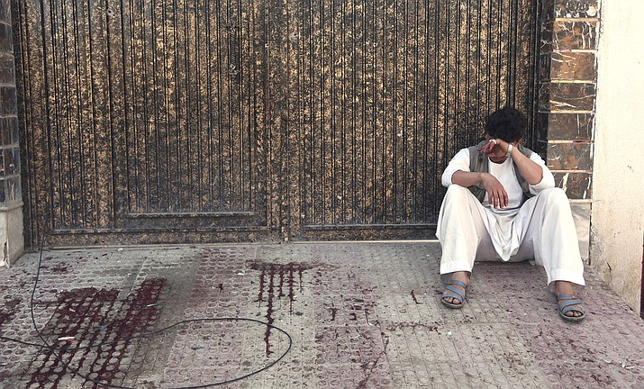 A relative of a victim weeps outside a voter-registration center that was attacked by a suicide bomber in Kabul, Afghanistan, Sunday, April 22, 2018. Gen. Daud Amin, the Kabul police chief, said the suicide bomber targeted civilians who had gathered to receive national identification cards. (Rahmat Gul/AP)