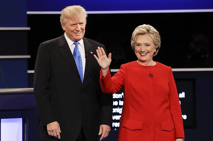In this Sept. 26, 2016, file photo, then-Republican presidential nominee Donald Trump and then-Democratic presidential nominee Hillary Clinton are introduced during the presidential debate at Hofstra University in Hempstead, N.Y. Almost 18 months have passed since Clinton lost the presidency. She holds no position of power in government or in her political party. And she is not expected to run for office ever again. Yet Clinton is starring in the Republican Party's 2018 midterm strategy. (AP Photo/David Goldman, File)
